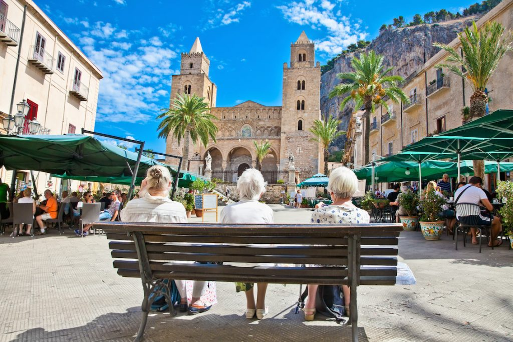Main square of Cefalu, medieval city of Sicily, Italy.